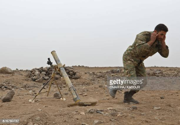 Syrian rebel fighters battle government forces near the village of Arafa east of the city of Hama in the central Hama province on November 20 2017...