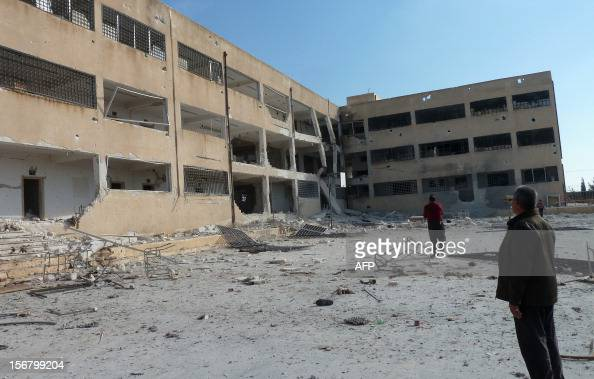 Syrian rebel fighters inspect Syrian army Base 46 compound after its capture near the northern city of Aleppo on November 21 2012Three days after...