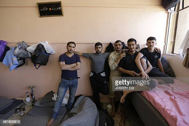 Syrian rebel fighters who surrendered to the government during the siege of Homs pose for a photograph at the AlAndalous school turned into a...