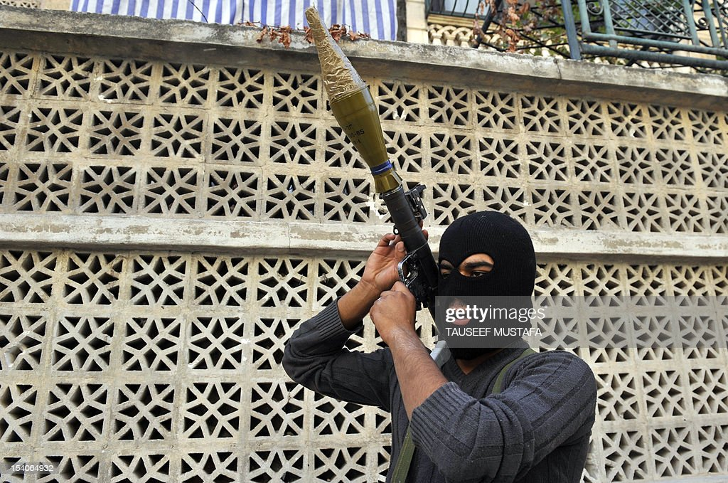 A Syrian rebel holds a rocket-propelled grenade launcher near a post in the Syrian northern city of Aleppo on October 13, 2012. Syrian rebels shot down a fighter jet in Aleppo a monitoring group and a military defector said, as fierce fighting in the region continues. AFP PHOTO/TAUSEEF MUSTAFA