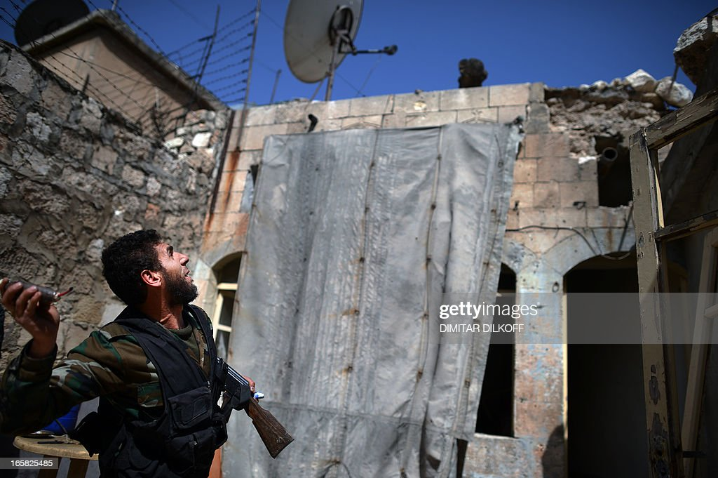 A Syrian rebel prepares to throw a handmade grenade towards a position held by regime forces in the old city of Aleppo in northern Syria on April 6, 2013. Syrian President Bashar al-Assad has warned that the fall of his regime would destabilise the region 'for many years', as US President Barack Obama announced talks with Middle East allies over the crisis.