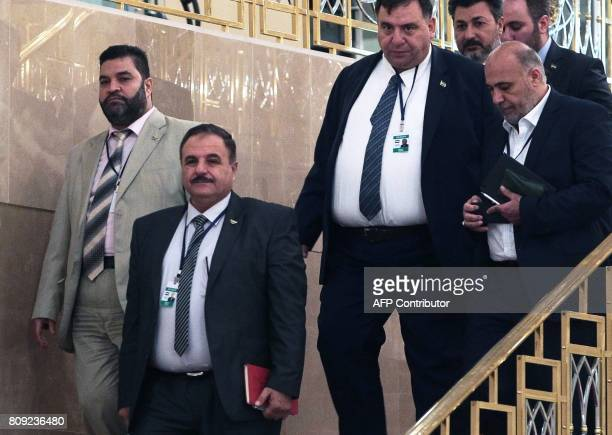 Syrian rebel representative General Ahmad Berri walks during a fifth round of Syria peace talks on July 5 in Astana Powerbrokers Russia Iran and...