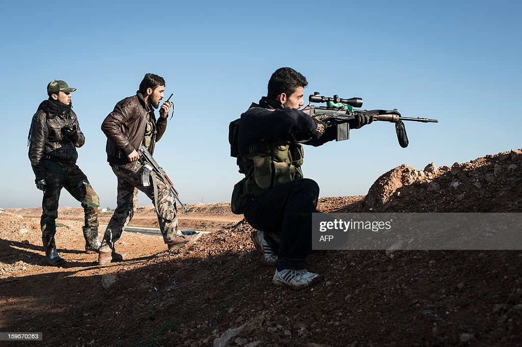 A Syrian rebel sniper takes aim at pro-government forces near the Abu Baker brigade in Albab, 30 kilometres from the northeastern Syrian city of Aleppo, on January 16, 2013. Universities were closed across Syria to mark a day of mourning called after twin blasts tore through an Aleppo campus while students were writing exams, killing at least 87 people. AFP PHOTO / EDOUARD ELIAS
