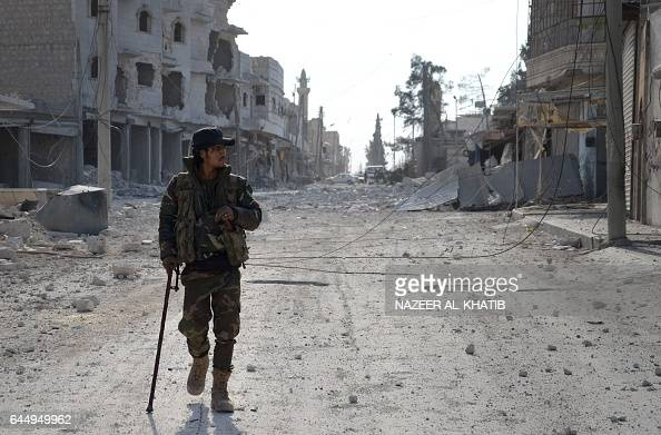 A Syrian rebel walks in the northwestern border town of alBab on February 24 2017 after Turkishbacked rebels announced the recapture of the town from...