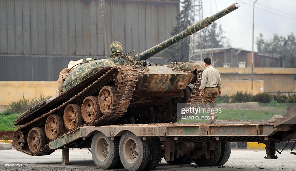 Syrian rebels deploy a Soviet-made T-55 tank in the Qadi Askar district of Aleppo as they prepare to fight regime forces in the Sheikh Said district of the northern city on February 8, 2013. Syrian forces shelled rebel belts, the Syrian Observatory for Human Rights said, as an army offensive raged into a third straight day.