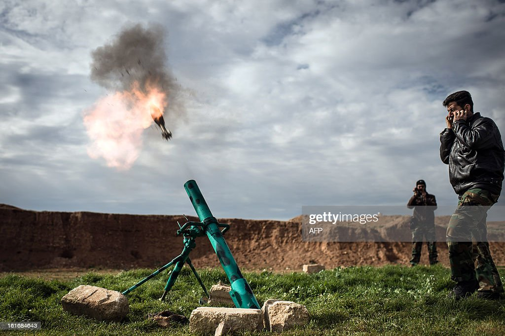 Syrian rebels fire a mortar towards regime forces stationed at Kwiriss airport in Al-Bab, 30 kilometres from the northeastern Syrian city of Aleppo, on February 14, 2013. Syrian Foreign Minister Walid al-Muallem and opposition National Coalition chief Ahmed Moaz al-Khatib will make separate visits to Moscow for talks in the coming weeks, a top Russian diplomat said.