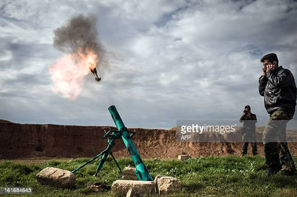 Syrian rebels fire a mortar towards regime forces stationed at Kwiriss airport in AlBab 30 kilometres from the northeastern Syrian city of Aleppo on...