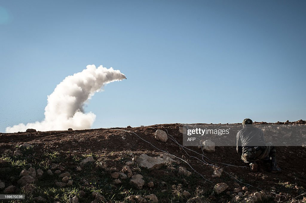 Syrian rebels launch a missile near the Abu Baker brigade in Albab, 30 kilometres from the northeastern Syrian city of Aleppo, on January 16, 2013. Universities were closed across Syria to mark a day of mourning called after twin blasts tore through an Aleppo campus while students were writing exams, killing at least 87 people.