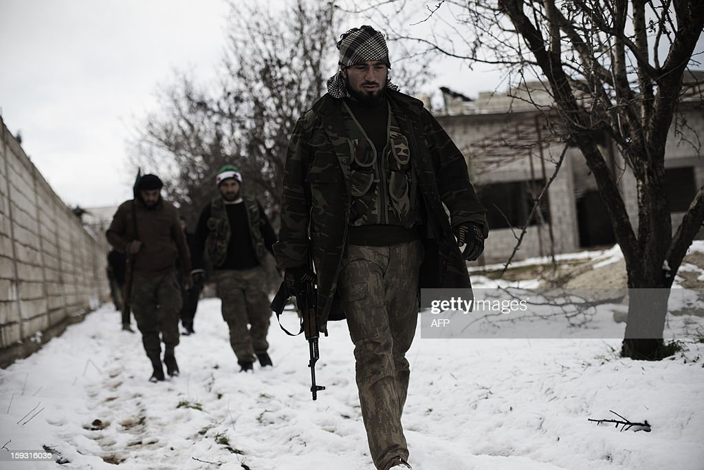 Syrian rebels move into a position before an attack on Syrian government troops defending the Minnigh military airport near the northern city of Aleppo on January 11, 2013. UN-Arab League peace envoy Lakhdar Brahimi expressed the urgent need to end the Syrian conflict after meeting with top US and Russian officials, but reported no concrete advances towards a solution.