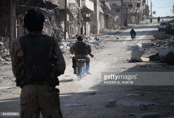 Syrian rebels patrol in the northwestern border town of alBab on February 24 2017 after Turkishbacked rebels announced the recapture of the town from...