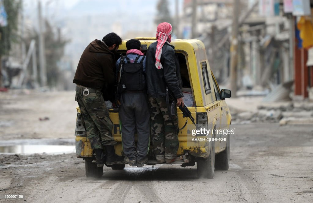 Syrian rebels patrol in the Sheikh Said district of the northern city of Aleppo on February 8, 2013. Syrian forces shelled rebel belts, the Syrian Observatory for Human Rights said, as an army offensive raged into a third straight day.