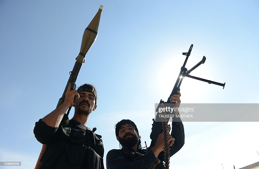 Syrian rebels patrol on their way to the frontline in the northern city of Aleppo on October 8 2012 A string of rebel bastions across Syria was...