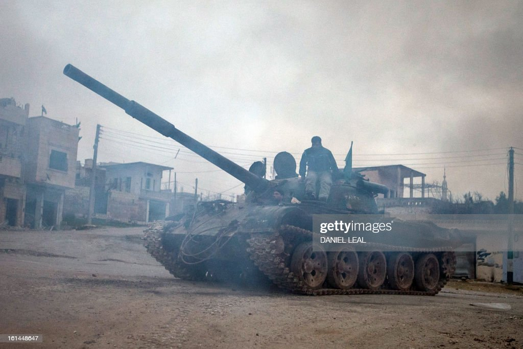 Syrian rebels relocate a T-72 tank, captured from government forces two months ago, in the village of Kfarruma in the flashpoint Syrian province of Idlib near the border with Turkey, on February 10, 2013. The rebels control large swathes of territory in northern and eastern Syria but have made little headway in major Syrian cities, where military stalemates have persisted for months.