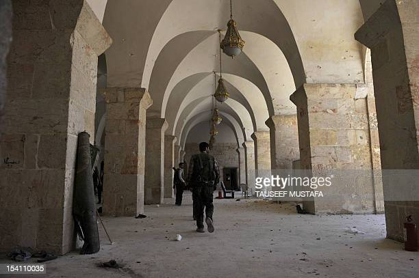 Syrian rebels take position at the Umayyad Mosque in the old city of Aleppo hours before the Syrian army retook control of the complex on October 14...