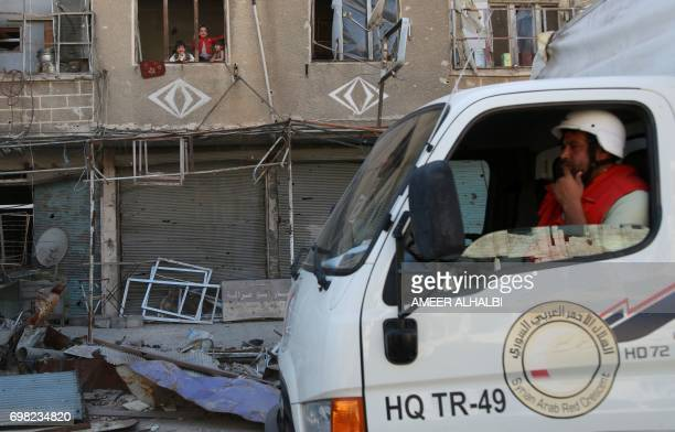 Syrian Red Crescent truck carrying aid drives through the rebel held and besieged town of Harasta in the Eastern Ghouta region outside Damascus on...
