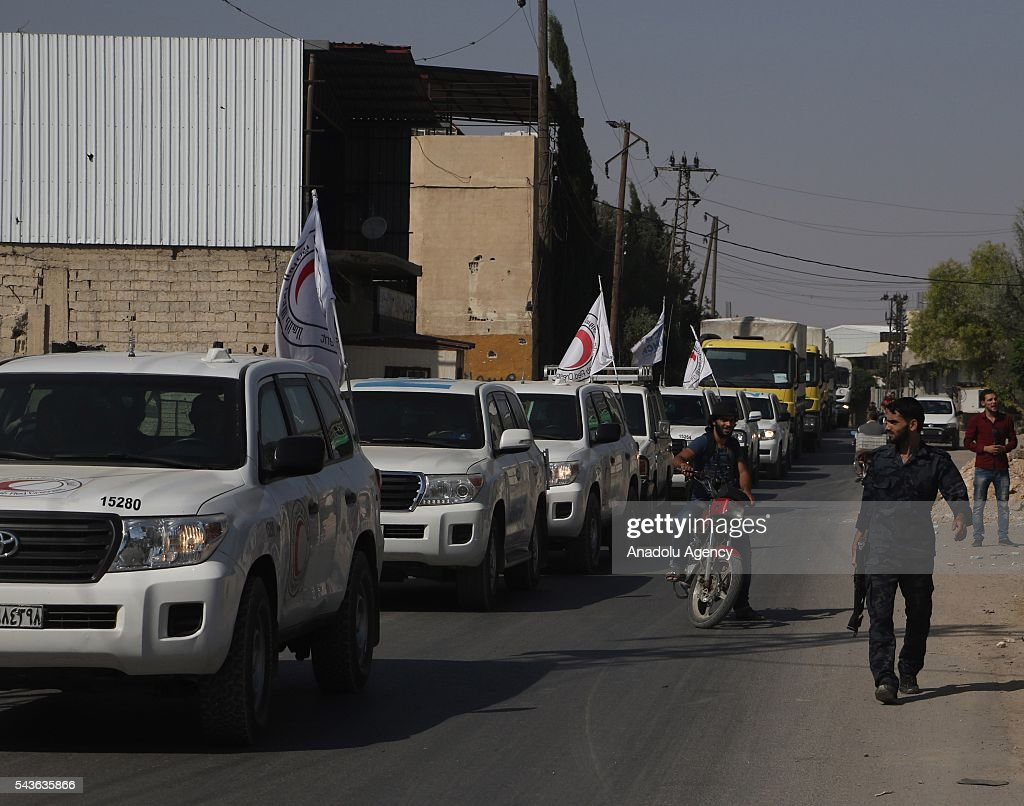 Syrian Red Crescent trucks, carrying humanitarian aid sent by United Nations (UN), arrive Arbin Town of East Ghouta Region of Damascus, Syria on on June 29, 2016.