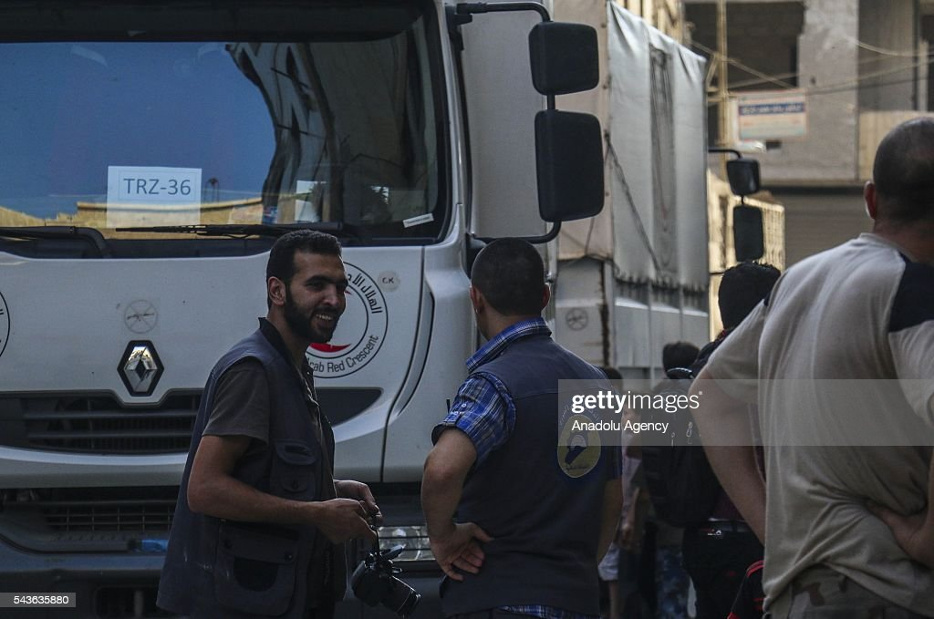 Syrian Red Crescent trucks, carrying humanitarian aid sent by United Nations (UN), arrive at Zamalka Town of East Ghouta Region of Damascus, Syria on June 29, 2016.