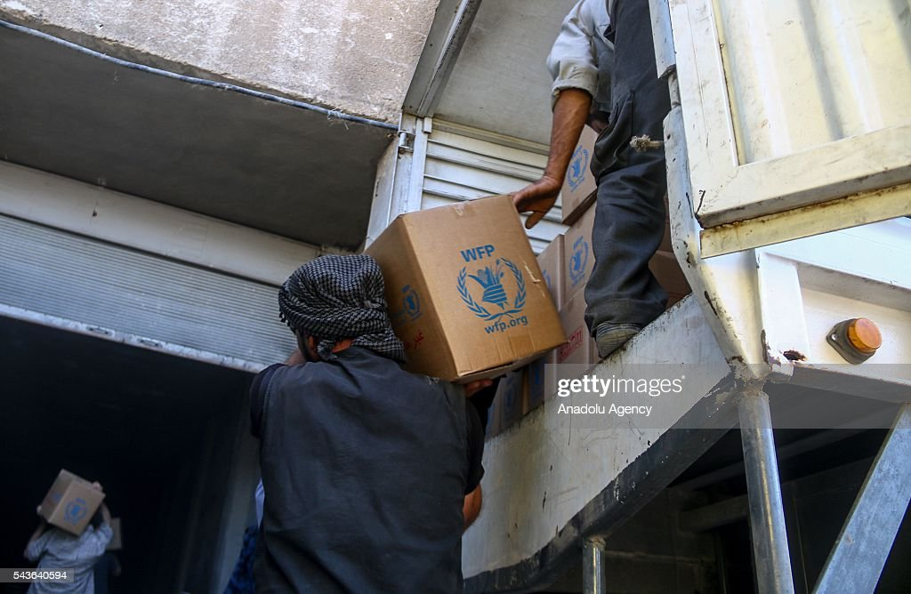 Syrian Red Crescent trucks, carrying humanitarian aid sent by United Nations (UN), arrive Arbin Town of East Ghouta Region of Damascus, Syria on June 29, 2016.