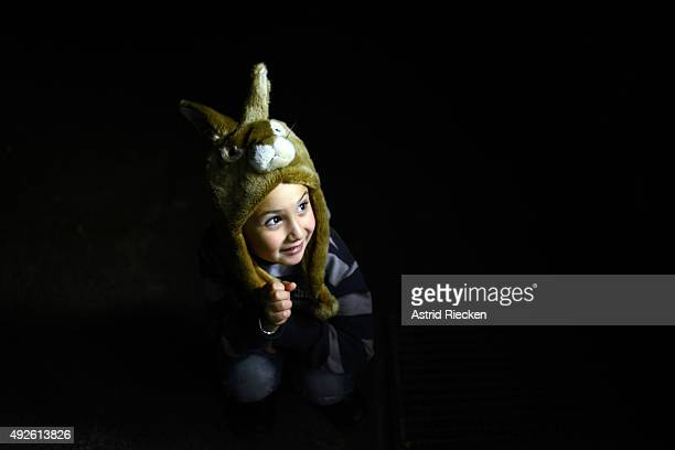 Syrian refugee Ali AlAwis wears a rabbit hat his father found at the Kleiderkammer early morning before leaving the community center of the...