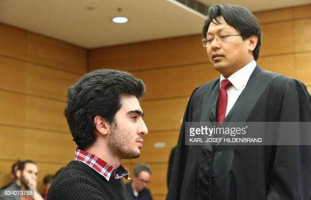 Syrian refugee Anas Modamani and his lawyer Chanjo Jun arrive at the district court in Wuerzburg southern Germany on February 6 2017 The Syrian...