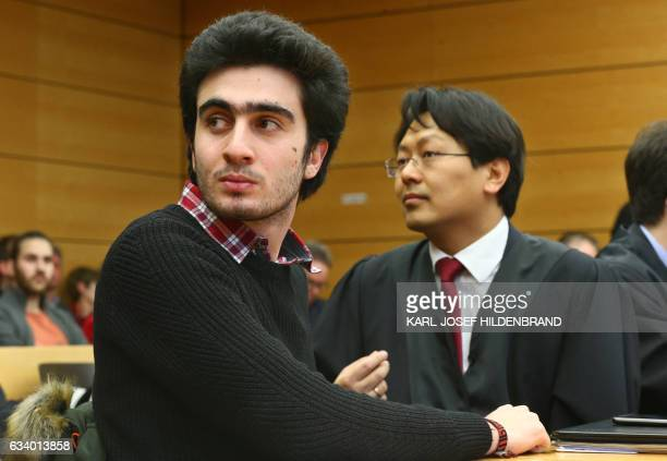 Syrian refugee Anas Modamani and his lawyer Chanjo Jun sit at the district court in Wuerzburg southern Germany on February 6 2017 The Syrian refugee...
