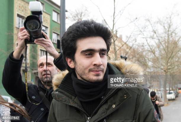 Syrian refugee Anas Modamani arrives at the district court in Wuerzburg southern Germany on February 6 2017 The Syrian refugee accuses the social...