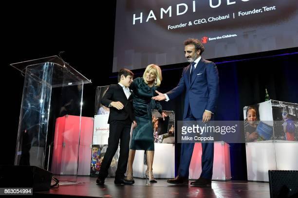 Syrian Refugee and Save the Children beneficiary Mahmoud Aloqla and Save the Children Board Chair Dr Jill Biden present the Humanitarian award to...
