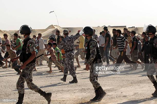Syrian refugee are seen rushing as UN Syria peace envoy Lakhdar Brahimi arrives at the at Zaatri refugee camp close to the northern Jordanian city of...