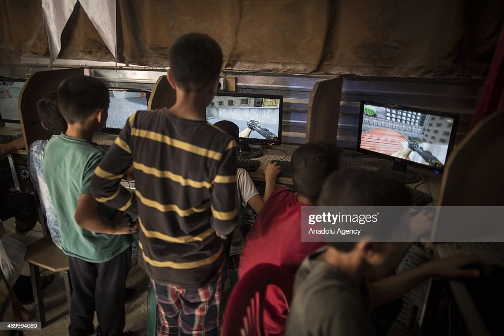Syrian refugee boys play war games on computers at an internet cafe at a tent city in the Akcakale District of Sanliurfa, Turkey on September 24, 2015. 260 thousand Syrians who have escaped war and found asylum in Turkey are now living in camps with opportunities that mean they don't miss what they've left behind.