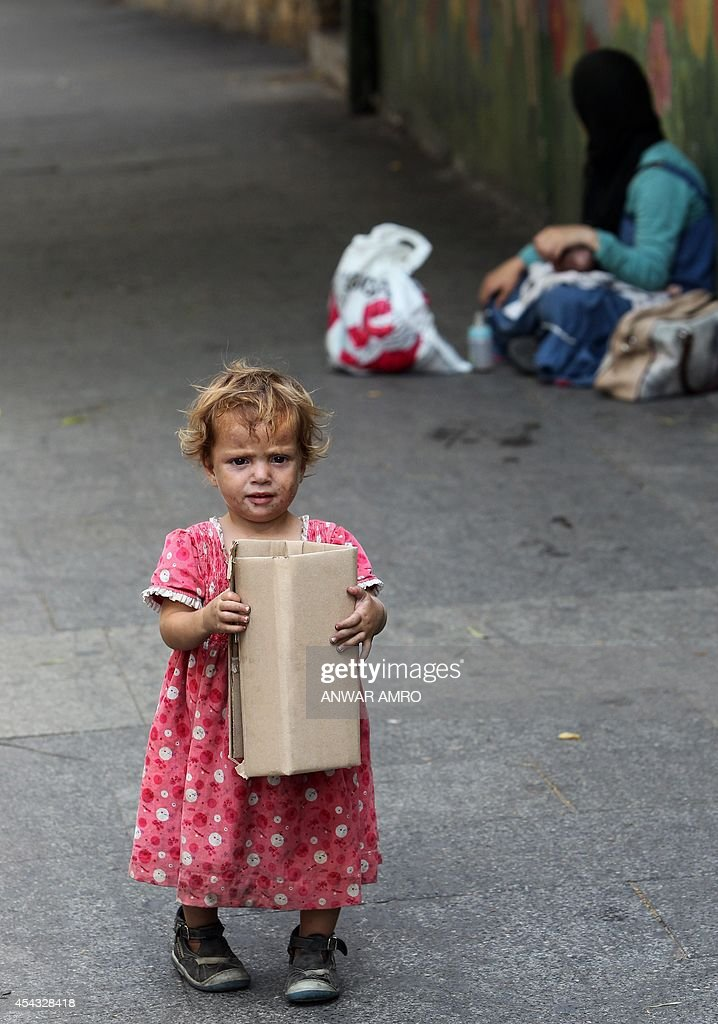 A Syrian refugee child begs for money on a street in the Lebanese capital Beirut on August 29 2014 The number of refugees from the conflict in Syria...
