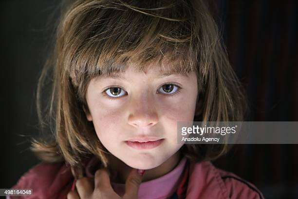 Syrian refugee child fled from her home due to civil war is seen at a house in Reyhanli district of Hatay on November 21 2015 Syrian refugee families...