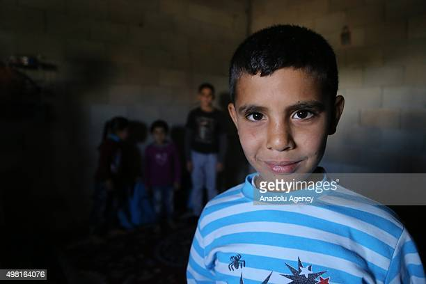 Syrian refugee child fled from his home due to civil war is seen at a house in Reyhanli district of Hatay on November 21 2015 Syrian refugee families...