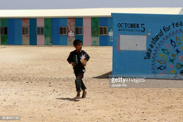 Syrian refugee child is seen at the innovation center that is run by Relief International and the unicef under the hot sun near his makeshift home at...