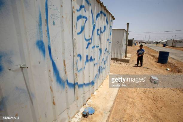 Syrian refugee child plays around under the hot sun near his makeshift home at the Azraq camp for Syrian refugees the newest camp in Jordan that...