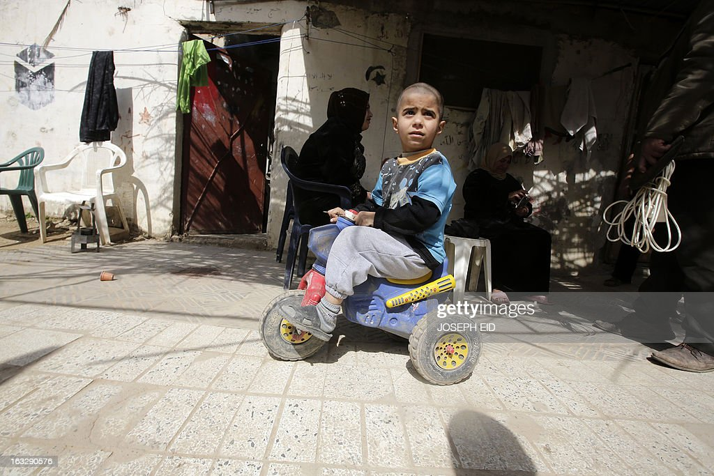 A Syrian refugee child rides his bicycle outside his shanty rented by their parents in a poor neighbourhood at the entrance of the northern Lebanese city of Tripoli on March 7, 2013. The number of Syrians who have fled their country since a deadly civil conflict erupted two years ago has hit one million, the UN's refugee agency said on March 6.