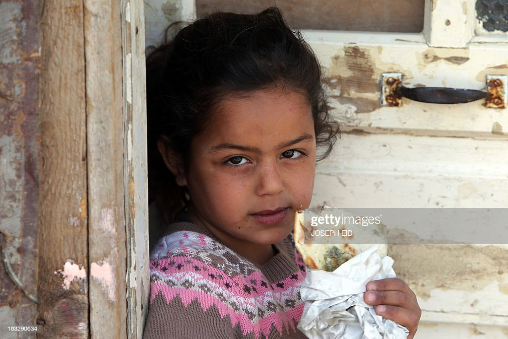 A Syrian refugee child stands outside her shanty rented by their parents in a poor neighbourhood at the entrance of the northern Lebanese city of Tripoli on March 7, 2013. The number of Syrians who have fled their country since a deadly civil conflict erupted two years ago has hit one million, the UN's refugee agency said on March 6.
