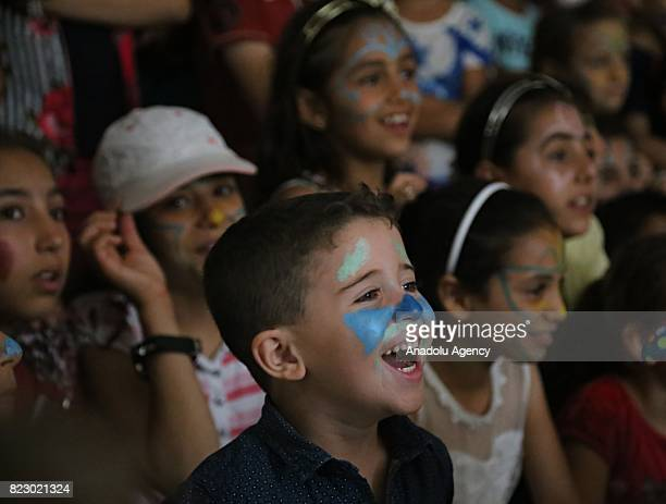 Syrian refugee children are being entertained by clowns during an entertainment activity that organized by an NGO in Antakya district of Syrian...