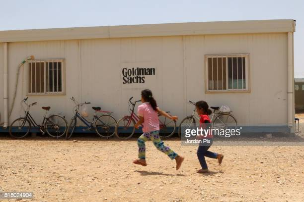 Syrian refugee children are seen playing around at the innovation center that is run by Relief International and the unicef under the hot sun near...
