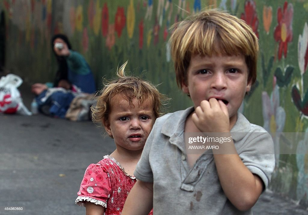 Syrian refugee children beg for money in the Lebanese capital Beirut on August 29 2014 The number of refugees from the conflict in Syria now tops...
