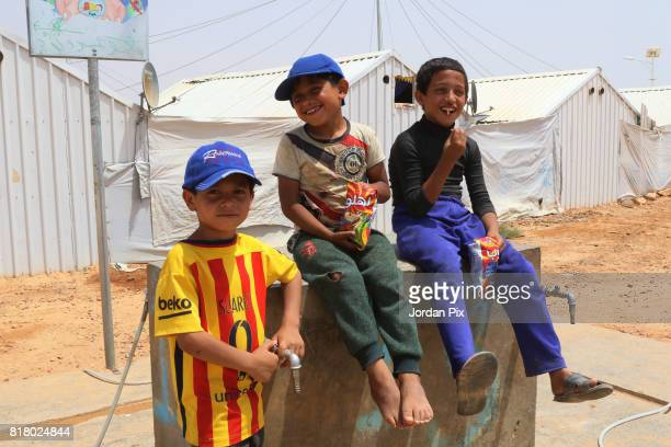 Syrian refugee children play around under the hot sun near his makeshift home at the Azraq camp for Syrian refugees the newest camp in Jordan that...
