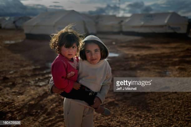 ZA'ATARI JORDAN JANUARY 31 Syrian refugee children play in the Za'atari refugee camp on January 31 2013 in Za'atari Jordan Record numbers of refugees...