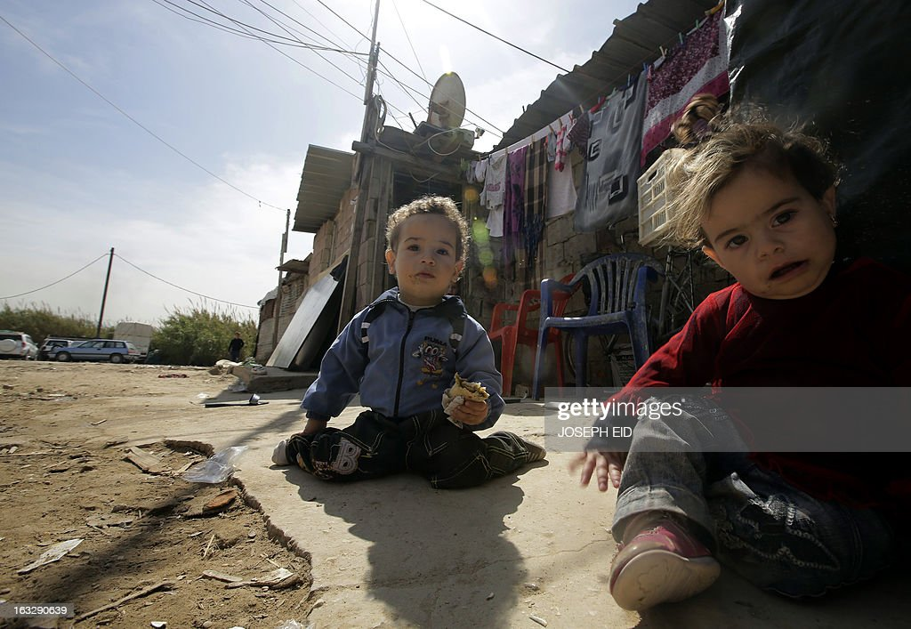 Syrian refugee children play outside their shanty rented by their parents in a poor neighbourhood at the entrance of the northern Lebanese city of Tripoli on March 7, 2013. The number of Syrians who have fled their country since a deadly civil conflict erupted two years ago has hit one million, the UN's refugee agency said on March 6.