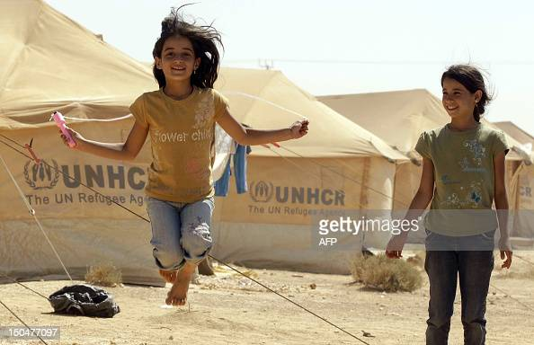 Syrian refugee children who felled the violence in their country with their families play at the Zaatari refugee camp close to the northern Jordanian...