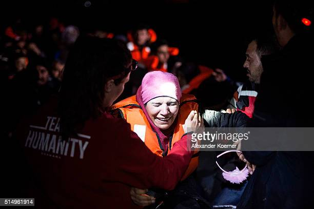 Syrian refugee cries shortly after arriving on an inflatable boat with other refugees crossing the sea from Turkey to Lesbos some 5 kilometres south...