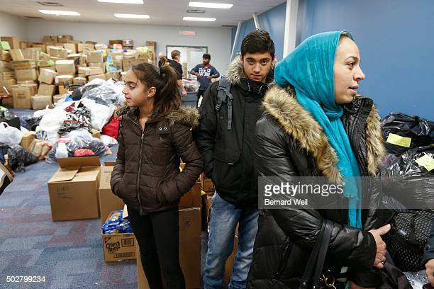 Syrian refugee family Fatima Mohammad 13 and mother Aisha Syrian wait to be seated for a dinner hosted by Friends of Syria at the Toronto Port...