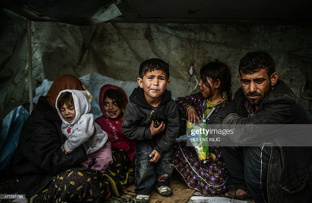 A Syrian refugee family from Aleppo stay under a shelter during a rainy day on March 8 at Uskudar in Istanbul More than 136000 people have been...