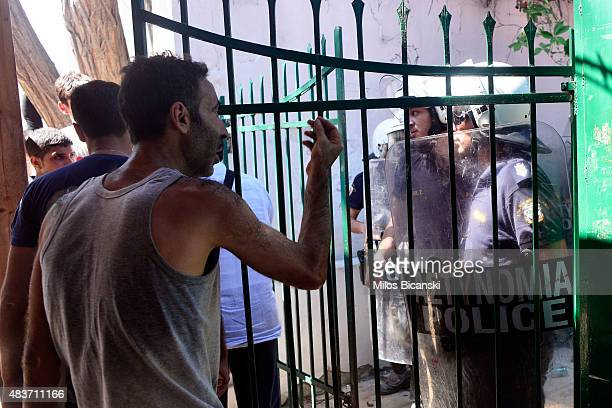 Syrian refugee gesticulates as Syrian refugees are pushed by riot police trying to maintain an orderly line during a registration procedure at the...