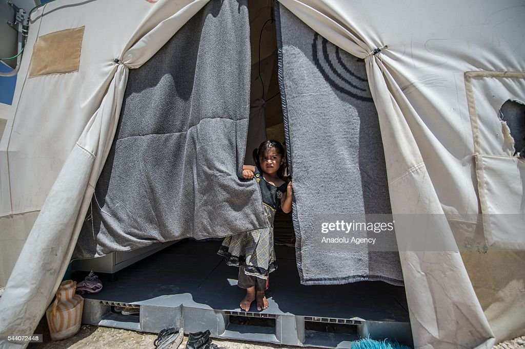 Syrian refugee girl is seen in Suruc district of Sanliurfa, Turkey on July 01, 2016, as the Syrian people who fled the clashes between Daesh and Kurdish armed groups about two years ego, make preparations for the Eid al-Fitr marks the end of the Muslim holy fasting month of Ramadan by preparing sweets despite the all harsh conditions at the camp away from their home.