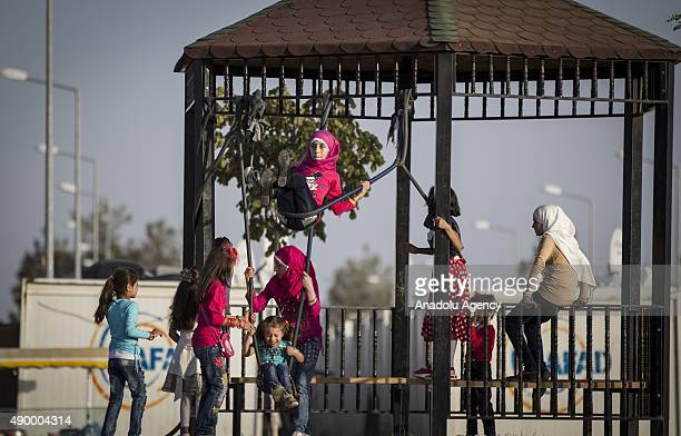Syrian refugee girls are seen at a tent city in the Harran District of Sanliurfa Turkey on September 24 2015 Turkish Red Crescent provided bank cards...