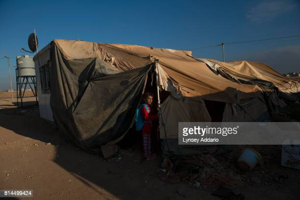 Syrian refugee girls walk to school in Zaatari camp in Mafraq Province Jordan September 14 2013 There are roughly 120000 Syrian refugees living in...